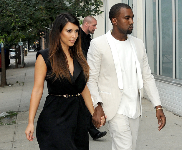 Kim Kardashian and Kanye West holding hands as they arrive at a store in Soho to go shopping New York City