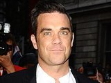 Robbie Williams arriving at the 2012 GQ Men Of The Year Awards at the Royal Opera House, London