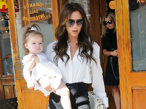 Victoria Beckham holding Harper Beckham in her arms leaving Pastis New York City