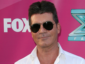 Simon Cowell at The X Factor USA Season 2 premiere screening and handprint ceremony at Grauman&#39;s Chinese Theater, Los Angeles