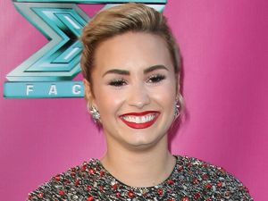 Demi Lovato at The X Factor USA Season 2 premiere screening and handprint ceremony at Grauman's Chinese Theater, Los Angeles