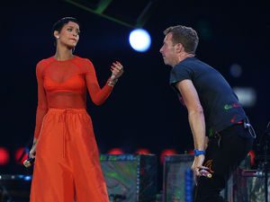 Rihanna and Chris Martin of Coldplay perform during the Paralympic Games closing Ceremony at the Olympic Stadium