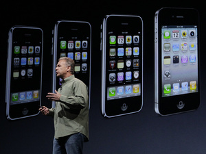 iPhone 5 launch event: Phil Schiller, Apple's senior vice president of worldwide marketing, speaks on stage during an introduction of the new iPhone 5 at an Apple event in San Francisco
