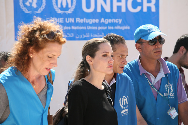 The U.N. refugee agency's special envoy, actress Angelina Jolie, center, arrives to the Zaatari Refugees Camp in Jordan for Syrians who fled the civil war in their country