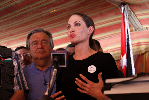 The U.N. refugee agency&#39;s special envoy, actress Angelina Jolie, center, arrives to the Zaatari Refugees Camp in Jordan for Syrians who fled the civil war in their country