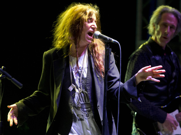 US rock singer Patti Smith performs during her concert in Mexico City, Saturday, May 5, 2012. At right guitarist Lenny Kaye.