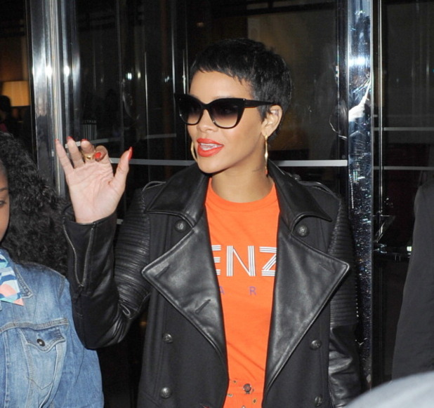 Rihanna in London wearing &#39;Hitman&#39; clothing