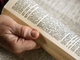 Stock image of a person using a dictionary