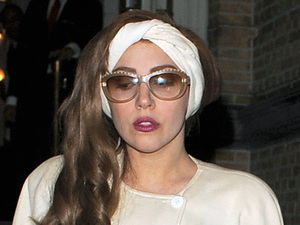 Lady Gaga leaves her hotel late at night and has pictures taken with her fans, who had waited for hours to see her, before getting on a tour bus to take her to Berlin. Lady Gaga also had an assistant handing out free samples of her new perfume, 'Fame' to the fans who had waited all day and night for the singer to emerge from her hotel. Amsterdam, Netherlands