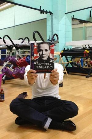 Strictly Come Dancing's Brendan Cole poses with Victoria Pendleton's memoirs during a rehearsal sesson