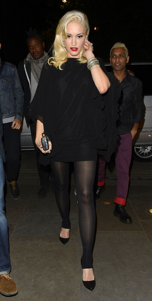 Gwen Stefani dressed in a short top and black tights at Novikov restaurant in Mayfair