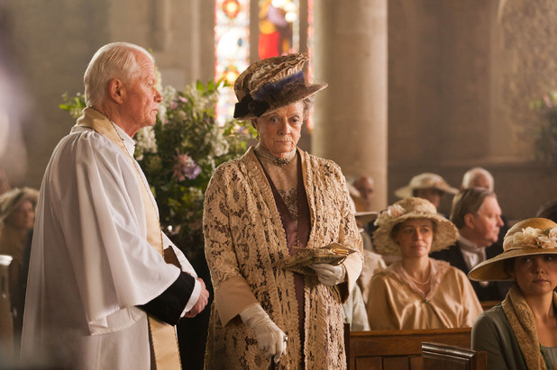 Michael Cochrane as Reverend Travis, Maggie Smith as Dowager Countess of Grantham, Violet