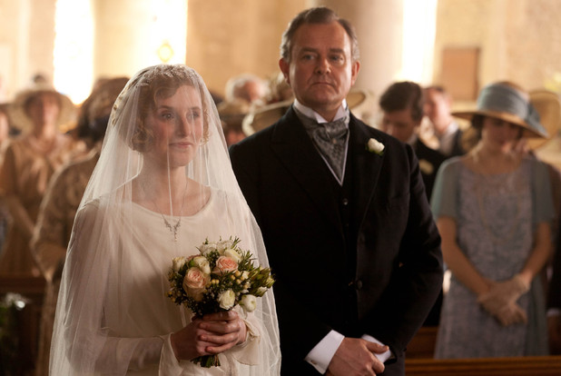 Laura Carmichael as Lady Edith, Hugh Bonneville as Earl of Grantham, Robert