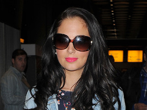 Tulisa Contostavlos arriving at Heathrow Airport on a late night flight from Glasgow. Tulisa was carrying a copy of &#39;Fifty Shades of Grey&#39;,  a bestselling erotic fiction paperback, written by E. L. James. It is notable for its explicitly erotic scenes.