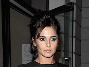 miss mode: Cheryl Cole enjoys a late dinner with new beau Tre Holloway at Sumosan restaurant in Mayfair. The couple spent around 3 hours inside the restaurant, before leaving together in a chauffeur driven car. Cheryl appeared to be in great spirits, and there was no sign of the sling she was pictured wearing a few days before, as a result of a car accident she had while in Los Angeles. London, England - 04.09.12 Mandatory Credit: Will Alexander/WENN.com