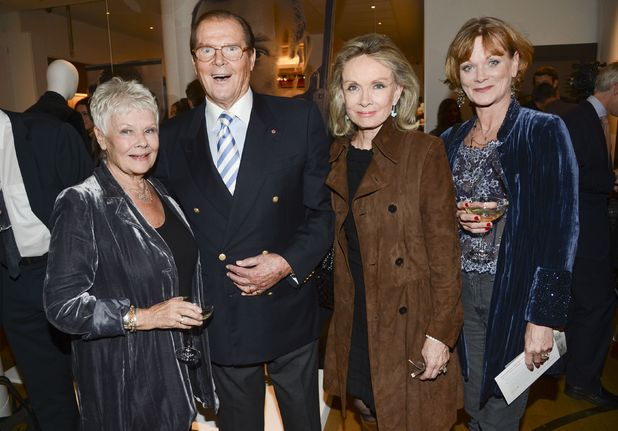 Dame Judy Dench, Roger Moore and Samantha Bond