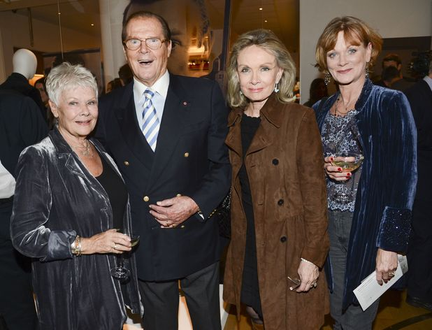 50 Years of James Bond: The Auction, Christie's, London, Britain - Dame Judy Dench, Roger Moore and Samantha Bond