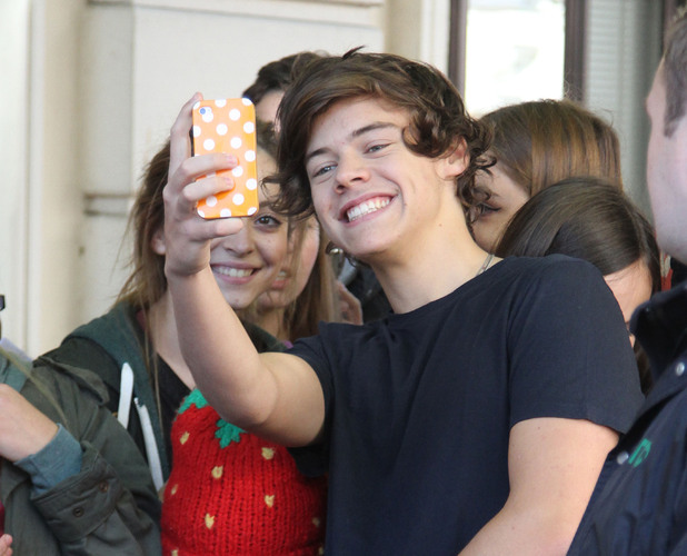 Harry Styles poses with fans outside Radio 1 studios