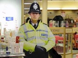 A Norfolk Constabulary cardboard Policeman stands guard as a deterrent to shoplifters, Palmers department store, Great Yarmouth, Norfolk, Britain - 30 Dec 2008