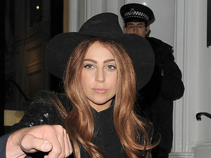 Lady Gaga leaves The Ecuadorian Embassy at midnight, having spent five hours inside visiting Wikileak&#39;s founder Julian Assange. Gaga made no comment as she left the premises.