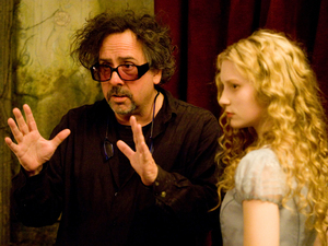 Tim Burton and Mia Wasikowska on set Alice In Wonderland, 2010