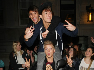 District3 are mobbed by fans outside the Corinthia Hotel.