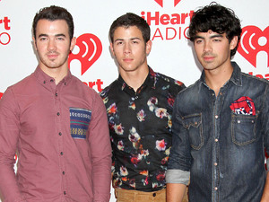 (L-R) Kevin Jonas, Nick Jonas and Joe Jonas of The Jonas Brothers, at the iHeart Radio Music Festival 2012 - Day 2 - held at The Grand Garden Arena at MGM Grand Resort and Casino - Arrivals. Las Vegas, Nevada