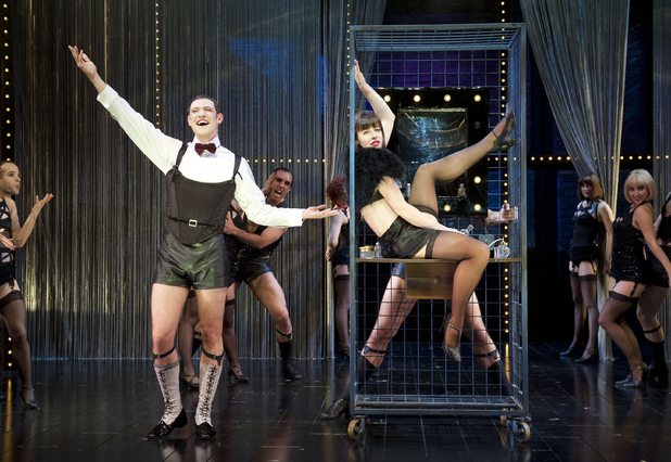 Michelle Ryan playing Sally Bowles, and Will Young playing Emcee, perform scenes from Cabaret, at the Savoy Theatre in London.