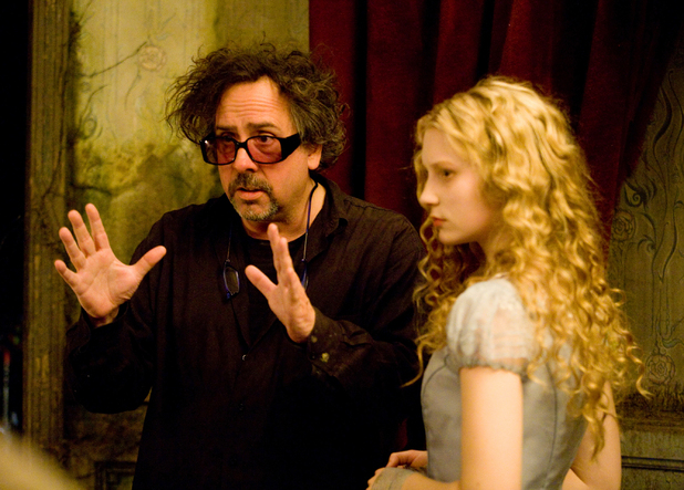 Tim Burton and Mia Wasikowska on set