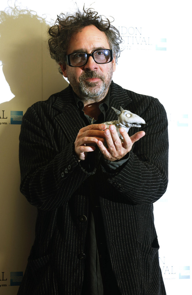 Frankenweenie Premiere: Tim Burton holding a puppet of Sparky a central character in the film  - at the Corinthia Hotel in London.