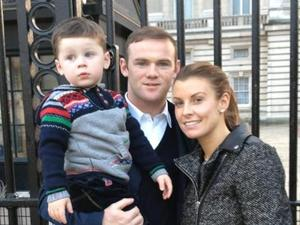 Coleen Rooney, Wayne Rooney and Kai Rooney outside Buckingham Palace