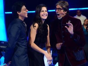 Shah Rukh Khan performing the 'Gangnam Style' dance during a promotional appearance on 'Kaun Banega Crorepati' with Katrina Kaif and host Amitabh Bachchan.