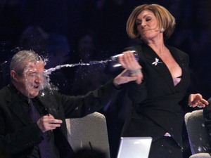 "Louis Walsh, Sharon Osbourne, X Factor 2005, Sharon Osbourne throws a glass of water over Louis Walsh after he threatened to quit the ITV show over alleged ""bullying"" by fellow judges including Osbourne and Simon Cowell back in series 2, 2005"