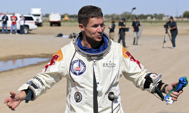 Felix Baumgartner talks to the media after his successful skydive from 24 miles (39km) above Earth - New Mexico, October 14, 2012