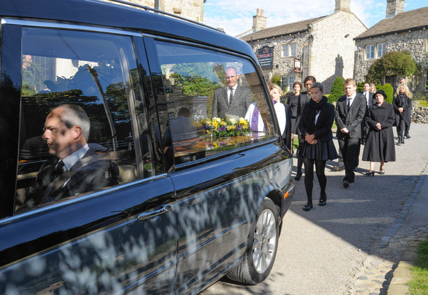 6385: The hearse of Carl makes it's way through the village