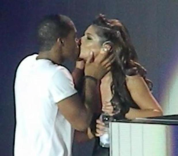 Cheryl Cole and Tre Holloway kiss on stage during A MIllion Lights tour performance