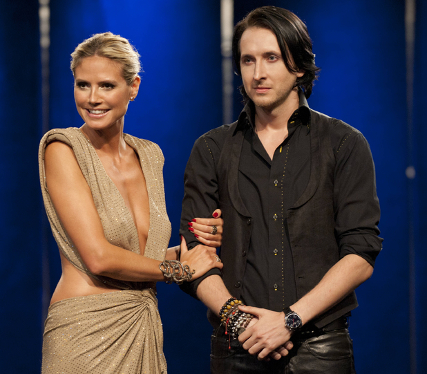 Heidi Klum with Project Runway season 10 winner Dmitry Sholokhov