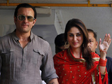 Saif Ali Khan and Kareena Kapoor step out on a balcony to greet waiting fans after getting married in Mumbai