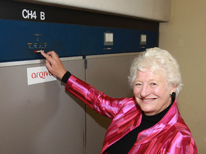 Dame Mary Peters hits the button to switch off Channel 4's analogue television channels across Northern Ireland at the Divis Transmitting Station in Belfast.