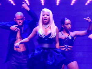 Nicki Minaj performs on stage at the Capital FM Arena during her 'Pink Friday: Reloaded Tour 2012' in Nottingham