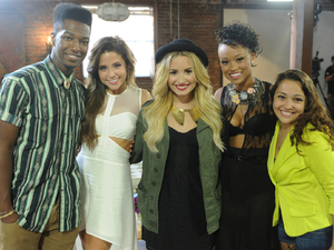 The X Factor USA: Demi Lovato with the successful contestants in the young adults category