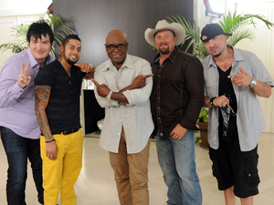 The X Factor USA: LA Reid with the successful contestants in the over-25s category