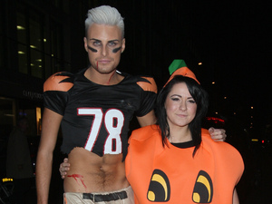 X Factor finalists Rylan Clark and Lucy Spraggon Leaving Mahiki Club after celebrating Rylan's birthday. The flamboyant model wore a Halloween style American football costume for the bash. London
