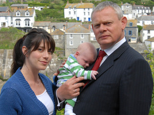 &#39;Doc Martin&#39;: Caroline Catz as Louisa Glasson and Martin Clunes as Dr Martin Ellingham with their baby son.