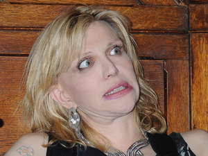 Courtney Love is presented with an honorary patronage from Trinity College Philosophical Society Dublin, Ireland