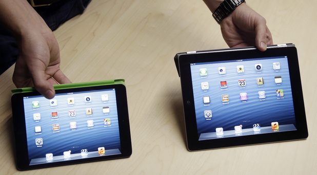 The iPad Mini, at left, is shown next to the 4th Generation iPad