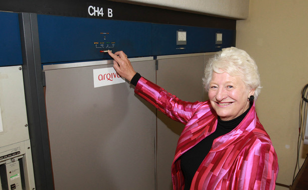 Dame Mary Peters hits the button to switch off Channel 4&#39;s analogue television channels across Northern Ireland at the Divis Transmitting Station in Belfast. 