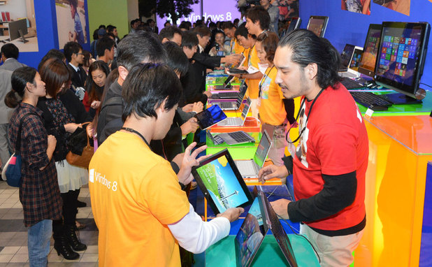 Consumers get their first chance to touch and try new Windows 8 devices at the Windows 8 launch event in Japan.