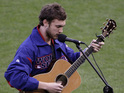 American Idol alum opens World Series with US national anthem.