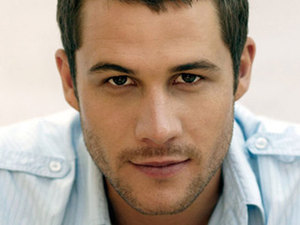 Scott McGregor as Detective Mark Brennan in Neighbours.